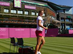 World No. 1 Victoria Azarenka of Belarus practices at a decked out Wimbledon All England Lawn Tennis and Croquet Club. Historic Wimbledon will host Olympic tennis.