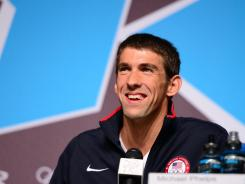 Michael Phelps addresses the news media Thursday before the London Olympics.