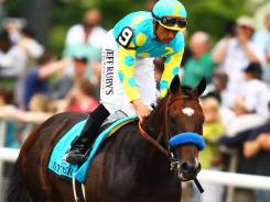 Mike Smith aboard Paynter after finishing second in the Belmont Stakes at on June 9.