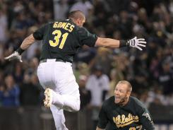 Looking up: A's teammates Jonny Gomes, left, and Brandon Moss celebrate after Moss' game-winning hit July 20, one of the team's 11 walk-off victories.