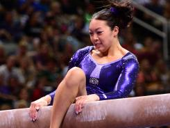 Anna Li, shown during the U.S. gymnastics team trials in June, fell Tuesday during training on the uneven bars at the Olympics.