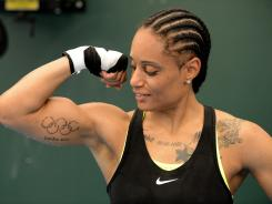 "Queen Underwood shows off her Olympic rings tattoo. ""I've always dreamed of being an Olympian,"" she says."