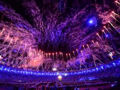 Fireworks explode over Olympic Stadium as the Opening Ceremony concludes.