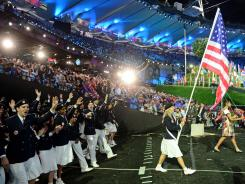 U.S. flagbearer Mariel Zagunis enters the Olympic Stadium during the opening ceremony for the 2012 London Olympics.