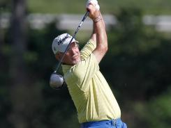 Pete Oakley, here hitting a tee shot during the Senior PGA Championship in May, was penalized two shots at the Senior British Open after his caddie, who is also his wife, could not locate his ball in the fairway.