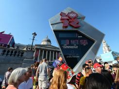 People gather around the Olympic Clock in London's historic Trafalgar Square on Wednesday.