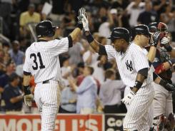 Yankees' Curtis Granderson is greeted by teammate Ichiro Suzuki after hitting a grand slam during the eighth inning against the Red Sox.