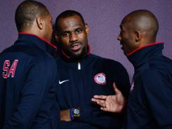 USA players Carmelo Anthony (left) , LeBron James (middle) and Kobe Bryant (right) talk during a press conference in preparation for the 2012 London Olympic Games at the Main Press Center.