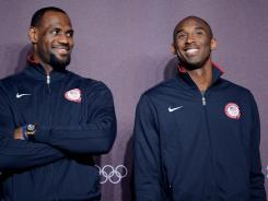USA forward LeBron James (left) and guard Kobe Bryant (right) stand on a stage during a press conference in preparation for the 2012 London Olympic Games at the Main Press Center.