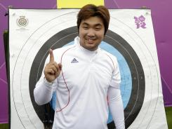South Korea's Im Dong-Hyun gestures after his world record during an individual ranking round at the 2012 Summer Olympics on Friday in London. Dong-Hyun set world record in the round with a 699 score.