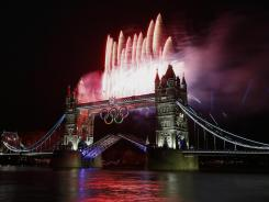 Fireworks burst over Tower Bridge and the River Thames in London during Opening Ceremonies at 2012 London Olympic games.