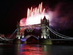 Fireworks burst over Tower Bridge and the River Thames in London during the opening ceremony for the 2012 London Olympics.