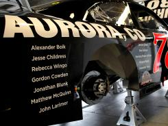 Names of the 12 shooting victims at an Aurora, Colo., movie theatre will adorn Regan Smith's No. 78 Chevrolet for Sunday's Sprint Cup race.