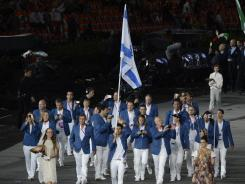 Flag bearer Shahar Zubari leads the 2012 Israeli delegation during the Opening Ceremony.