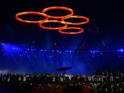 Olympic rings hang over the stadium during the Opening Ceremony.