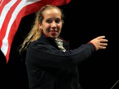 Fencer Mariel Zagunis, two-time fencing gold medalist in saber, will carry the U.S. flag.