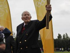 Sir Roger Bannister, the original 4-minute miler, is the bettors' favorites to light the caldron at the opening ceremony.