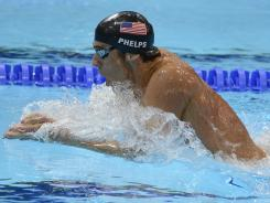 Michael Phelps, swimming the breastroke leg of the 400-meter individual medley, will next take to the pool in the men's 4x100 freestyle relay.