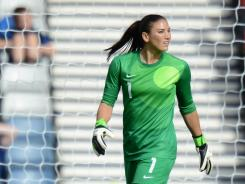 Glasgow, United Kingdom; USA goalkeeper Hope Solo (1) looks to her teammates during the women's preliminary match against France at Hampden Park. USA won the match 4-2.