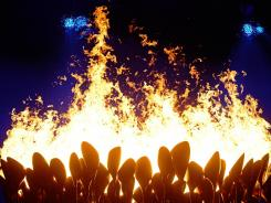 The Olympic flame was the subject of one of the biggest surprises of Friday's opening ceremony. Former Olympians Roger Bannister and Steve Redgrave had been oddsmakers' favorites to light the cauldron, but seven young athletes received the honor.