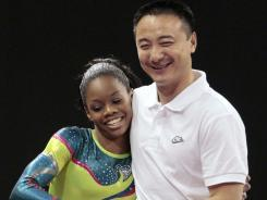 Gabby Douglas with her coach, Liang Chow. Douglas moved to Chow's gym in the fall of 2010.