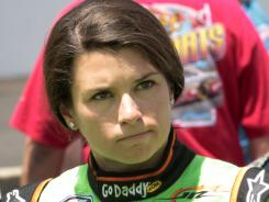 Danica Patrick waves to the crowd before Saturday's Nationwide Series race at Indianapolis.