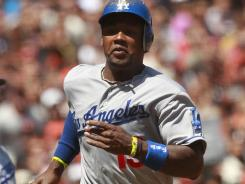 Los Angeles Dodgers infielder Hanley Ramirez (13) races towards home before scoring a run against the San Francisco Giants in the sixth inning at AT&T Park.
