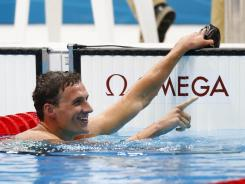 Ryan Lochte reacts after winning the gold medal in the men's 400 individual medley in the London Olympics at the Aquatics Center. Michael Phelps was fourth.