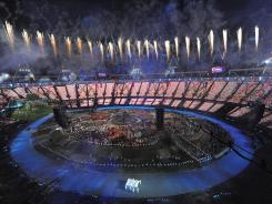 Fireworks explode over the stadium during the opening ceremony for the London Games at Olympic Stadium.