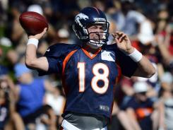Denver Broncos quarterback Peyton Manning participates in the team's first padded practice of training camp.