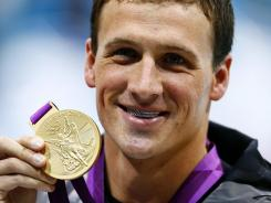 Ryan Lochte shows off his bling with a smile after receiving the gold medal for winning the 400-meter IM in London on Saturday.