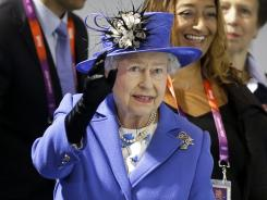 Britain's Queen Elizabeth II waves to spectators inside the Aquatics center during a visit to the Olympic Park on Saturday.