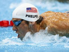 Michael Phelps struggled in the 400 IM as fellow American Ryan Lochte claimed the gold medal.