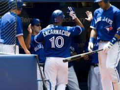 Toronto Blue Jays' Edwin Encarnacion celebrates a solo home run against the Detroit Tigers during the fourth inning.