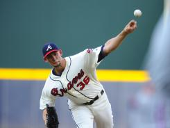 Atlanta Braves pitcher Mike Minor pitches against the Philadelphia Phillies during the first inning at Turner Field.