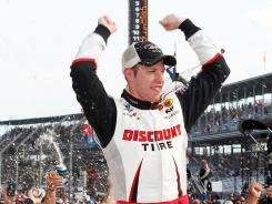 Brad Keselowski celebrates after winning the first Nationwide Series race at Indianapolis Motor Speedway on Saturday.