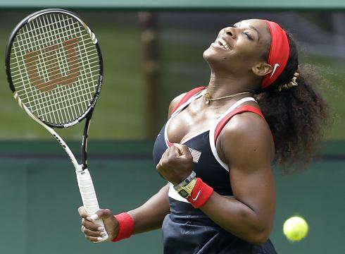 Serena Williams of the USA enjoys the moment after defeating Jelena