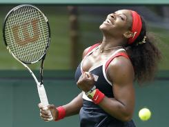 Serena Williams of the USA enjoys the moment after defeating Jelena Jankovic of Serbia in a first-round Olympic singles match Saturday at Wimbledon.