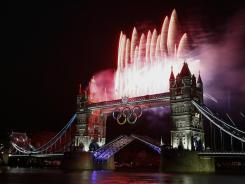 Fireworks burst over Tower Bridge and the River Thames in London during the opening ceremonies of the London Games.