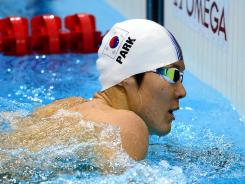 South Korea's Olympic and world champion Park Tae-hwan touched the wall first in his heat of the 400 freestyle Saturday, then found out he had been disqualified. He was reinstated when video showed he did not commit a false start.