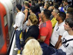 The crowds on the Tube headed for Friday night's opening ceremony, as shown here, were moderately heavy. But by Saturday's first full day of competition, the system was much less crowded and running smoothly.