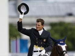 U.S. equestrian Boyd Martin reacts after he competes with his horse Otis Barbotiere in the eventing dressage competition Saturday at the London Olympics. Martin, who stands 13th out of 37 competitors, has overcome challenges that put in perspective however he does at the Olympics.