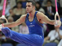 Danell Leyva, competing on the rings, was the top all-around qualifier after two groups in men's gymnastics team qualifying, helping the USA into an early lead.