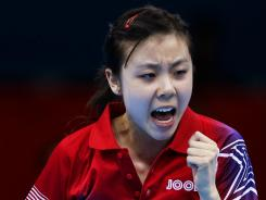 Ariel Hsing of the USA pumps her fist during her opening table tennis victory against Yadira Silva of Mexico on Saturday at the Olympics.