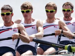 U.S. rowers, left to right, Robin Prendes, Nicholas la Cava, William Newell and Anthony Fahden, compete during a lightweight men's rowing four heat at Dorney Lake. They finished last in their five-team heat.