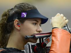 Sarah Scherer of the USA reloads her rifle during the women's 10-meter air rifle qualification round at the Royal Artillery Barracks.