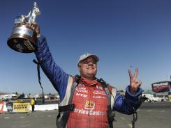Johnny Gray celebrates after beating defending series champion Matt Hagan and racing to his second Funny Car victory of the season.