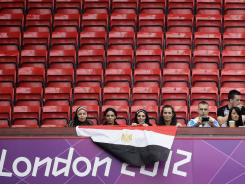Empty seats dot Old Trafford Stadium in Manchester for Sunday's soccer match between Egypt and New Zealand.