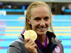 London, United Kingdom; Dana Vollmer (USA) poses with her gold medal after winning the women's 100m butterfly finals with a world record time during the London 2012 Olympic Games at Aquatics Centre.