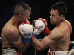 Robert Guerrero, right, lands a left hook on Selcuk Aydin during the second round of a WBC interim welterweight title fight in San Jose. Guerrero won by unanimous decision.
